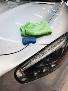 a car is being washed to avoid vinyl wrapping mistakes